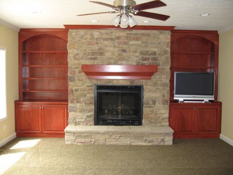 Cut Stone Fireplace Custom Built Cherry Wood Bookcases