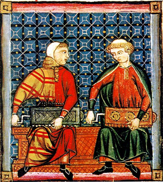 Musicians wear two long tunics, one over the other. The tunic on the left is an early example of mi-parti or particolored clothing, made from two fabrics. Cantigas de Santa Maria, mid-13th century, Spain.