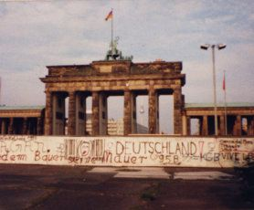 The Brandenburg Gate in 1987. This photo is taken from West Berlin, with the Berlin Wall running directly in front of the gate. If you look carefully you can see the East Berlin TV Tower, Alex, in between the columns of the gate.