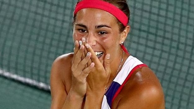 Monica Puig beats Angelique Kerber in three sets in the women's singles final to win Puerto Rico's first ever Olympic gold medal.