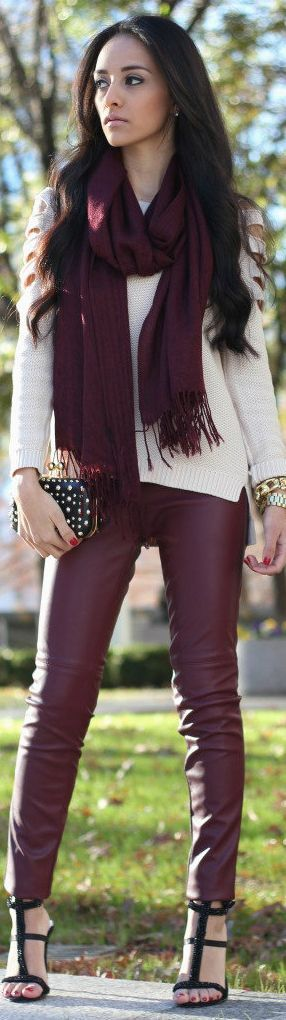 You can get this look at Banana Republic by pairing BR's Red Coated Skinny ankle jean with the cream color-blocked v-neck pullover, finishing it with the black fancie quilted purse and Helen scarf.