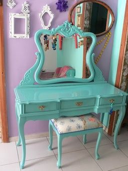 So I actually had this vanity as a kid! My mom spray painted it this color when she handed it down to me, to match my room. She also put a coat of glitter spray paint over it. Ahh the memories :)