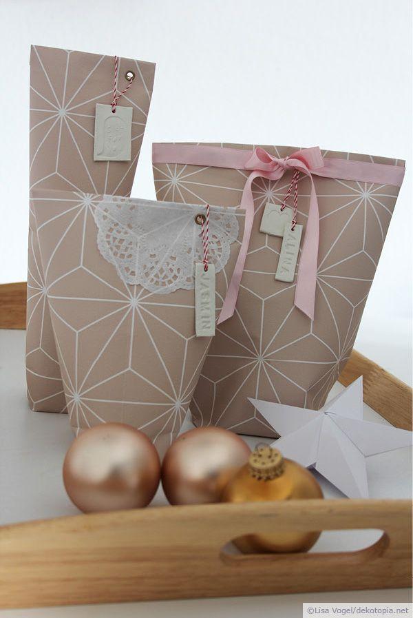 """Ihr kennt bestimmt alle diese Geschenke, die sich einfach unmöglich in Geschenkpapier einschlagen lassen. Kerzen, Flaschen, Tassen, im Prinzip alles, was keine eckige Form hat. Die """"Bonbon-Verpacku..."""