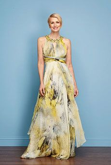 The painterly blue-and-yellow print on this silk-chiffon dress couldn't be more hip, while the high waist and layered skirt cleverly camouflage any lumps and bumps. The jeweled collar draws the eye up—perfect for showing off a toned top half; $790, Rickie Freeman for Teri Jon.