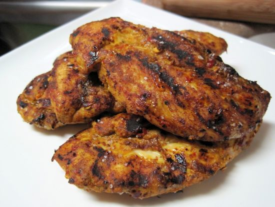 TANDOORI CHICKEN RECIPE    1/2 t curry powder  1/2 t red pepper flakes  1/4 t ground ginger  1/4 t smoked paprika  1/4 t cinnamon  1/4 t turmeric  2 T water  salt and pepper  1 package chicken tenders or breasts  olive oil spray  Mix curry, red pepper, salt, ginger, paprika, cinnamon, and turmeric with water to form a smooth paste. Rub paste on tenders and let marinate for 30 min.  At med heat cook tenders in a grill pan with a bit of olive oil spray for about 3 min on each side till done.
