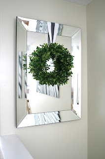 The 25 best wreath over mirror ideas on pinterest Decorate a large wall cheaply