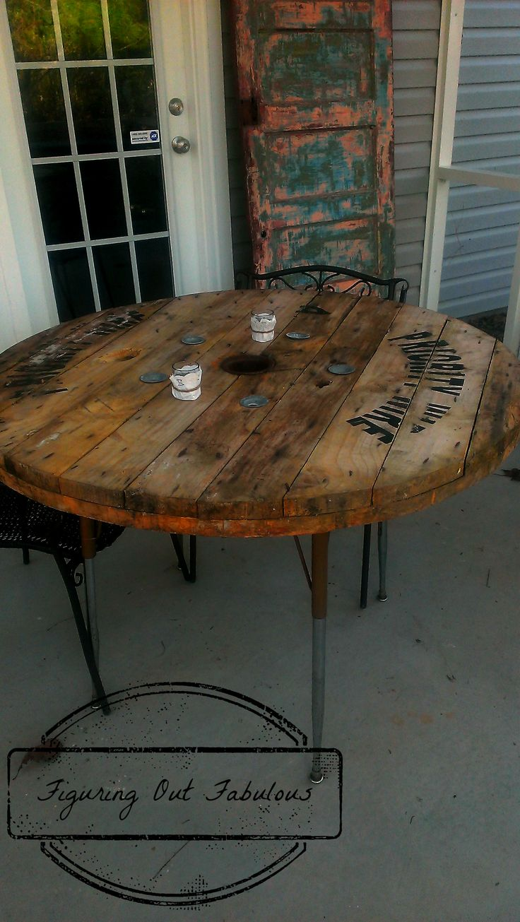 Patio table made from cable spool and an old student desk.
