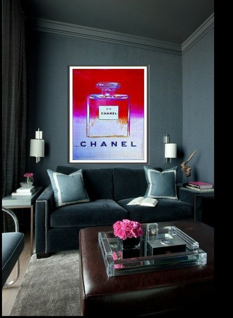 Chanel Art and luxurious velvet sofa make this small living room space big on style.