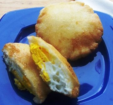 Arepa de Huevo or arepa Filled with Egg | Arepa de Huevo is a typical dish from the Caribbean region of Colombia where they are sold on street stalls. These arepas are served in Colombian homes for breakfast, but I remember my family making them for dinner so you can serve them at any time of the day. | From:mycolumbianrecipes.com