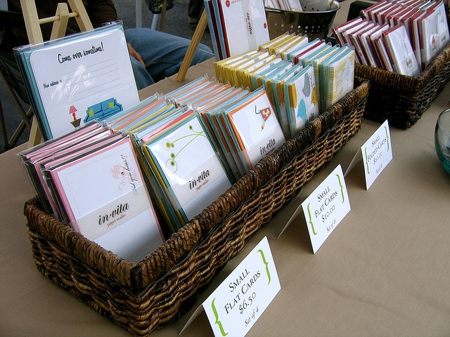 craft fair booth. Baskets organize. Folded cards provide prices.