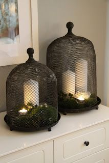 And of course, candles under cloches, wire or glass......BLOMSTERDESIGN.NET