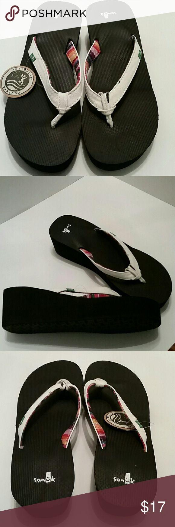 Sanuk size 9 white wedge flip flops NWOT  White wedged flip flops. Never worn Sanuk Shoes Sandals