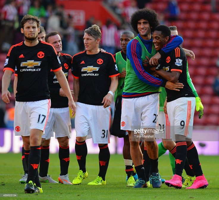 Anthony Martial of Manchester United (9) and team mate Marouane Fellaini (27) celebrate after victory