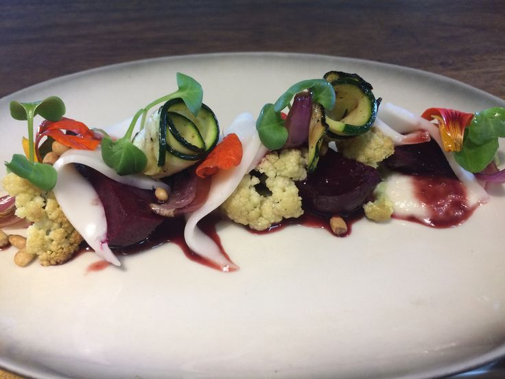 A new dish at The Open House restaurant ROASTED BABY BEETROOT & SOFT GOAT CHEESE with eggplant puree, grilled zucchini, caramelized Spanish onion, cauliflower, rucola & red wine reduction