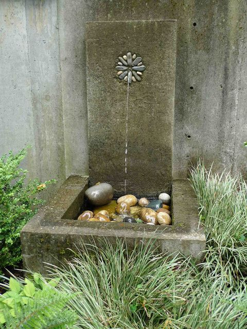 Jeffrey Bale's World of Gardens - For simplicity and because I find single spout of water to be very elegant, I tend to build a lot of wall fountains...and because they are fairly easy to build.  Flexible copper tubing that is usually meant for ice machines makes an excellent piping for the water.  This can be mortared in to the masonry work for the vertical part of the fountain.  I cast these in a form and then stand them up.  A sunken basin holds the submerged pump and catches the water.