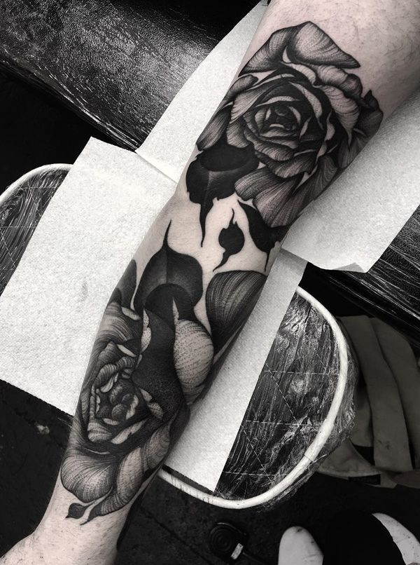 A group of beautiful roses sleeve tattoo. There's nothing like inking yourself with your favorite flowers or something as beautiful as this floral design, the grayscale effect also makes them look peaceful and mysterious.