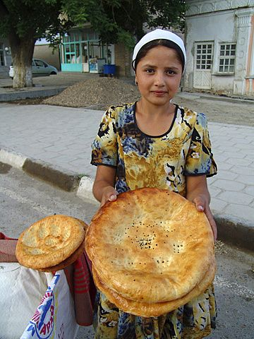 Uzbekistan girl selling bread, bukhara. There is no bread as delicious!!!