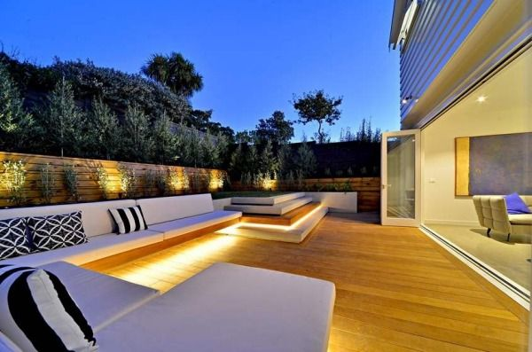 Built-in seating with downlighting wraps around the rear deck.