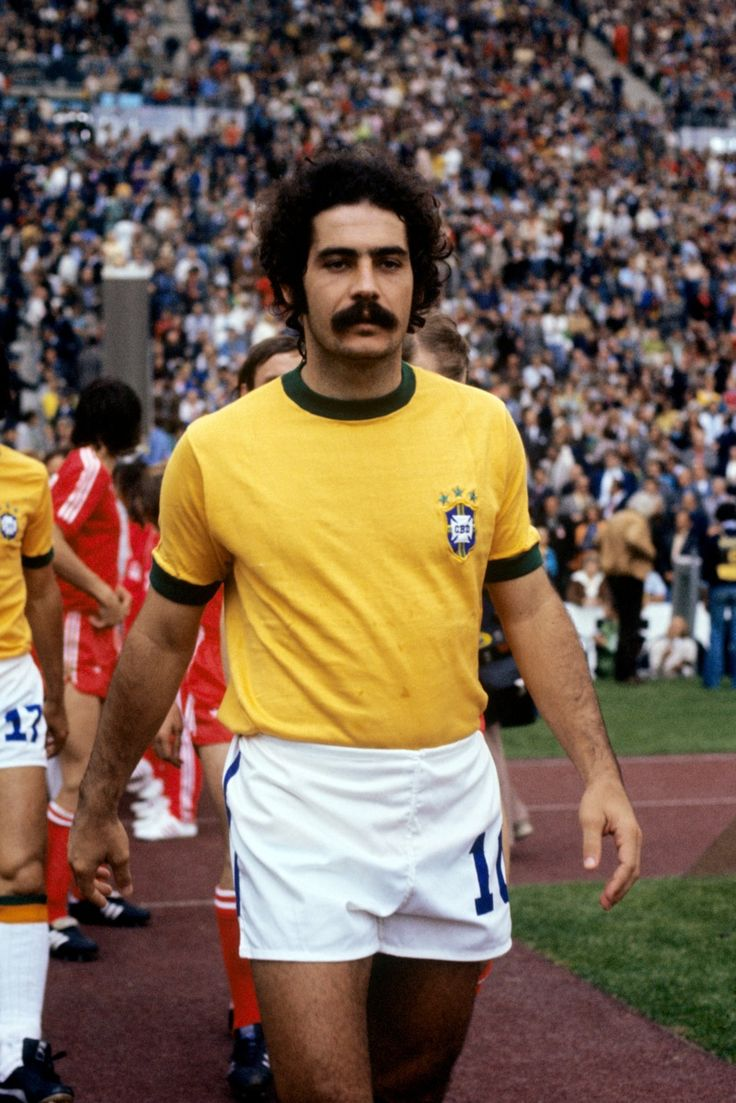 "Roberto Rivellino (also Rivelino), born 1 January 1946, Brazilian international attacking midfielder (1965-1978), Corinthians (1965–1973), Fluminense (1973–1978), Al-Hilal (1979–1981). Rivellino was a key member of Brazil's 1970 FIFA World Cup winning team, which is often cited as the greatest-ever World Cup team. Deployed on the left side of midfield, he scored 3 goals, including the powerful free-kick against Czechoslovakia, which earned him the nickname ""Patada Atómica"" (Atomic Kick) by…"