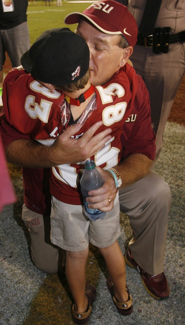 Florida State coach Jimbo Fisher kisses his son Ethan, 7, after the game. (AP Photo/Phil Sears)