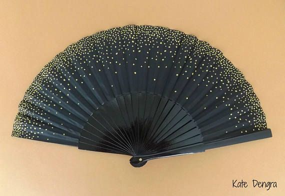 ITEM Wooden hand fan with fabric border Finished with a gold champagne bubble effect design Hand fan is black Choose your size from the dropdown menu (photo shows the 24cm version *final look of the fan will vary slightly from size to size.....if you want to see how your size option will look before purchasing then please get in touch) Made to order - for current turn around times see shop announcement (normally 7 days) SIZES (for fans) A lot of my designs will now be available in various...