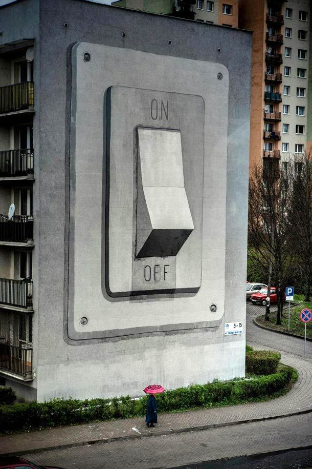 Spanish street artist escif recently painted this giant on/off switch on the side of a building in Poland for the Katowice Street Art Festival.