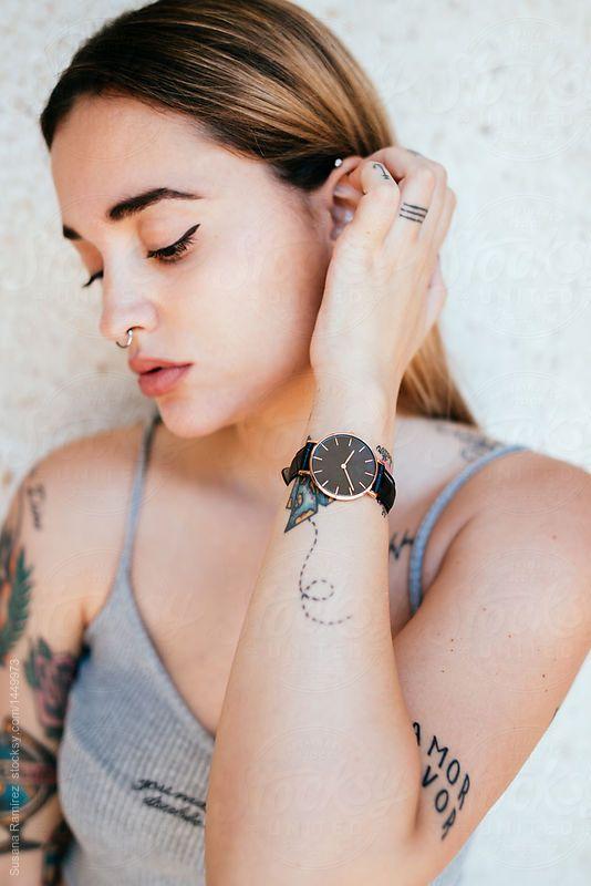 Portrait of woman with wrist watch by Susana Ramírez for Stocksy United