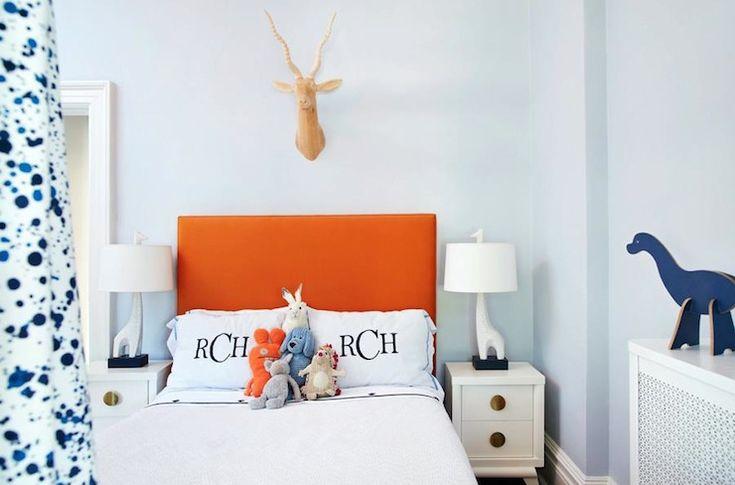 Suzie: Amie Corley Interiors - Orange & blue boy's bedroom with blue walls paint color, orange ...