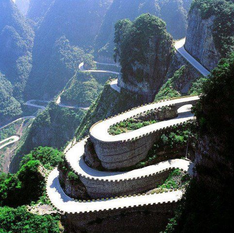 Tianmen Mountain, Hunan Province, China. Tianmen mountain boasts the stunning mountain road, 1,279m cable car, a super high glass floored viewing platform, several caves to explore including Tianmen cave which is at the highest elevation of any cave in the world, plus temples, stairs into the mountains and hundreds of species of plant and animal, some very rare.