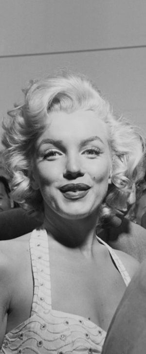 1953: Marilyn Monroe at a film premiere ….