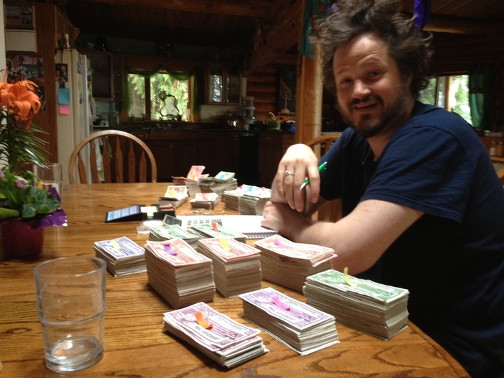 Corin counting his latest collection of bills on tour in BC - May 2012. At this point he has $3650.00 worth of Canadian Tire Money, sent to him from all corners of the country, handed to him on the street, stuffed in his pockets at shows... send yours to 39 Oxford Street, Toronto ON M5T 1N8!!