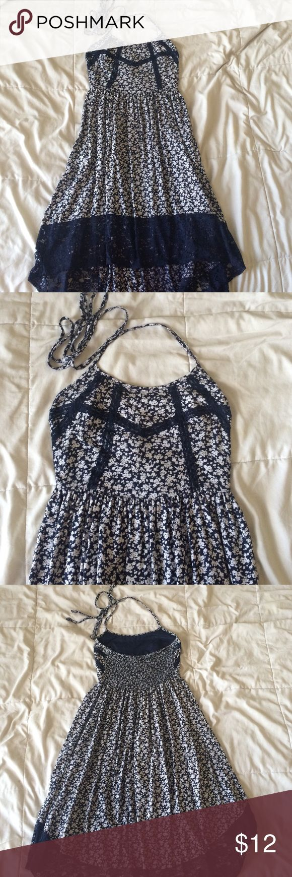 floral halter sundress halter dress with navy and white floral pattern, lace accents, and hi-lo hemline. 100% rayon with 100% cotton lining. Band of Gypsies Dresses High Low