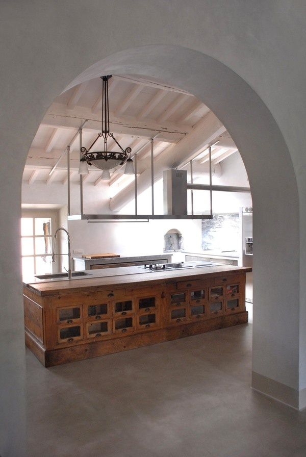 Beautiful apothecary kitchen island with exposed wooden beams.