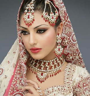 asian wedding makeup was the title but look at that beautiful jewelry also.  Wow she is beautiful.