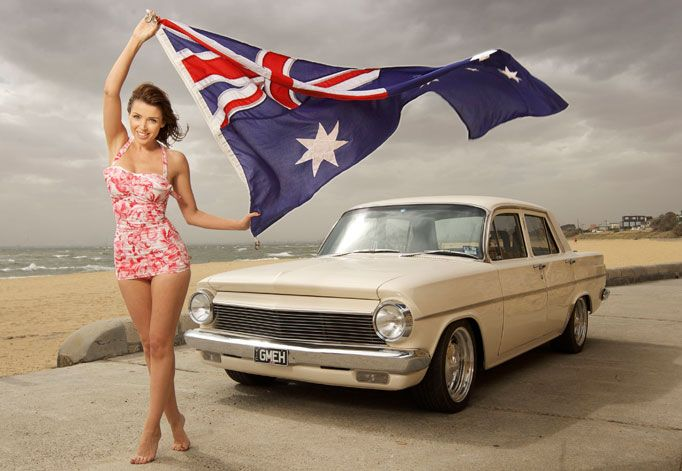 A shelia, an aussie flag and an eh holden....true blue