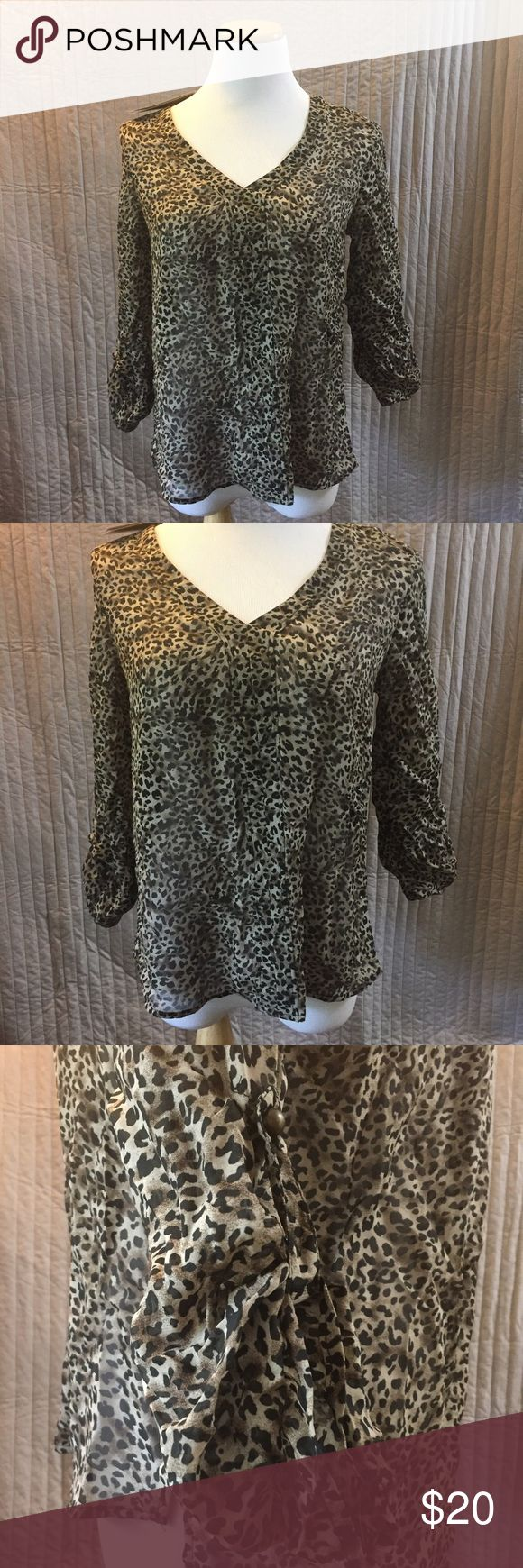 Francesca's Cheetah Print Shirt Brand new Francesca's Cheetah printed shirt. Size SM, the bottom of the sleeves have a button, deep V in the front, and 100% polyester. Francesca's Collections Tops