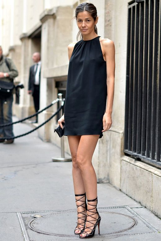 Shop this look on Lookastic:  http://lookastic.com/women/looks/black-silk-shift-dress-black-leather-clutch-black-suede-heeled-sandals/10554  — Black Silk Shift Dress  — Black Quilted Leather Clutch  — Black Studded Suede Heeled Sandals