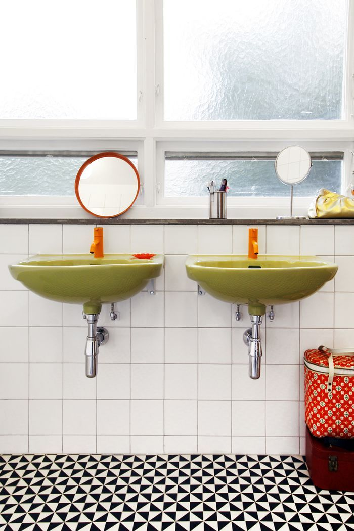 bright green sinks black and white floor orange accents this colorful bathroom design is really unique