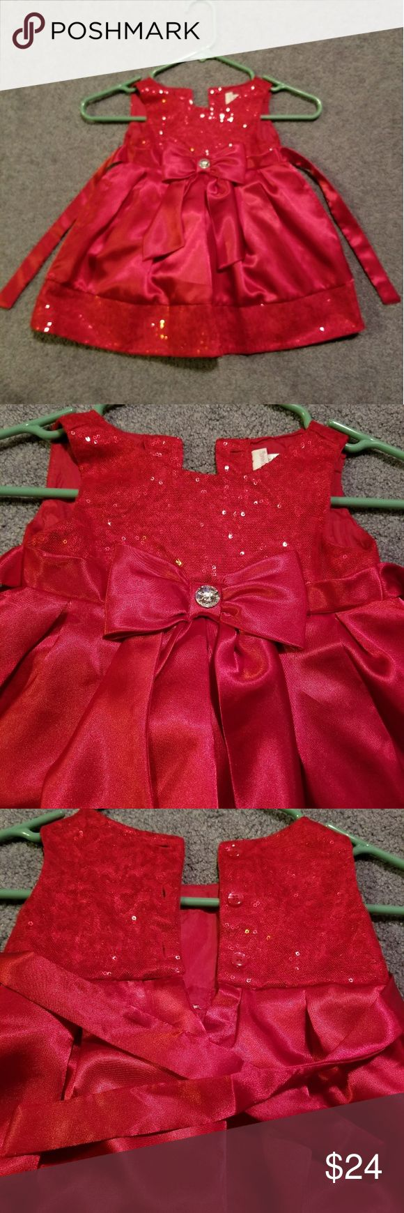 Toddler girl Christmas dress EUC red satiny Christmas dress. Sleeveless, button and tie back. Sequin top and trim. Front bow with jewel detail. Pet free, smoke free house. Youngland Dresses Formal