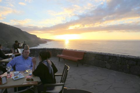 Mirador de San Pedro lookout with sunset enjoyed by people eating out in Los Realejos of Tenerife North.