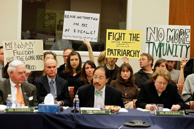 THE TROUBLE WITH TEACHING RAPE LAW  By Jeannie Suk Gersen , DECEMBER 15, 2014 // Members of the audience hold signs during a board of visitors meeting about sexual assault at the University of Virginia.