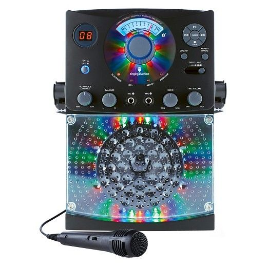 Host a dance party with the SML385BTBK Singing Machine Karaoke system featuring a top loading CD player that plays music CDs and CD + Graphics. Wirelessly stream digital audio from any Bluetooth compatible device. Hi-Fi LED disco lights effect set the perfect party ambience. <br><br>Product Features: <br><br>• Top loading CD Player plays music CDs plus CD + Graphics<br>• Bluetooth for wireless digital audio streaming from compatible devices<b...