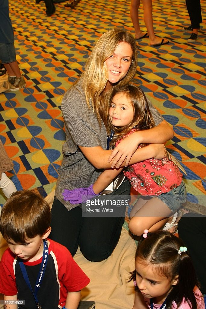 Sports Illustrated Swimsuit model Brooklyn Decker poses with children of wounded Heroes during a Camp C.O.P.E. session on December 3, 2007 in Orlando, Florida.