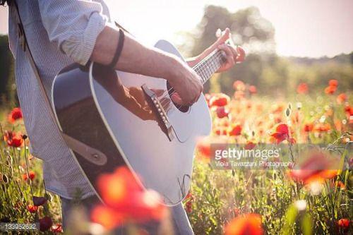 04-11 Man playing guitar in poppy field. #monleale... #monleale: 04-11 Man playing guitar in poppy field. #monleale… #monleale