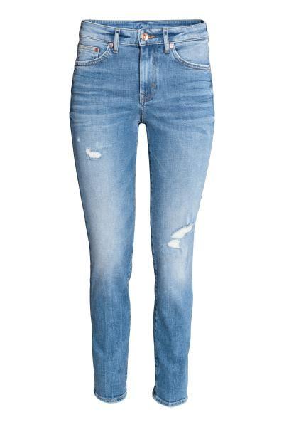 Enkellange 5-pocketjeans van elastisch, gewassen denim met forse slijtagedetails. De jeans heeft een normale taille, een gulp met rits en knoop en smalle pi