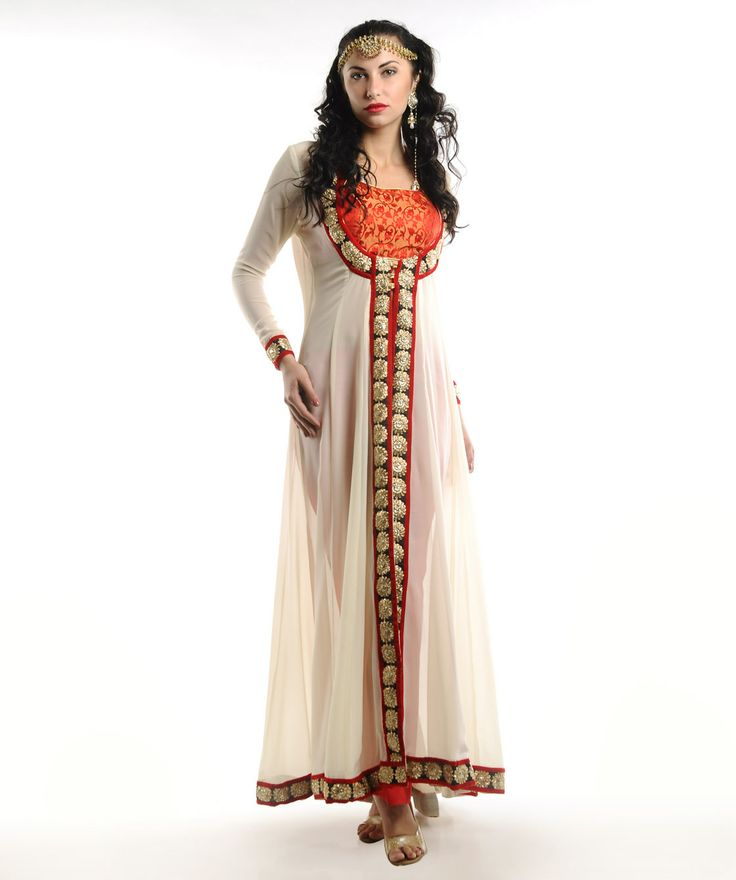 fashionandyou.com brings to you Drapes & Silhouettes  a brand driven by the spirit of fashion. With unique and varied styles of the Indian yarn  this collection is highlighted with exclusive designs.  Adorned with colourful threads and vivacious hues  it gives an ethnic and aesthetic look to your attire.BRAND: D&SCATEGORY: Kurta with Palazzos and BlouseCOLOUR:  - Kurta: Cream - Palazzos: Red - Blouse: Red and GoldMATERIAL:  - Kurta: Georgette - Palazzos: Crepe - Blouse: BrocadeSIZE: This…