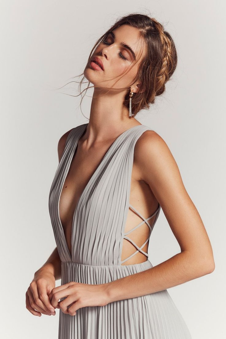Allegra Maxi Dress | Elegant and ethereal, this pleated maxi dress features a plunging neckline and strappy, criss-cross details along the open sides. * Sultry slit * Hidden back zipper closure * Lined