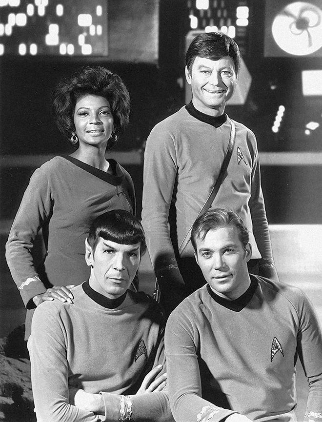 Nichelle Nichols (Uhura), DeForest Kelley (Bones), Leonard Nimoy (Spock), William Shatner (James T. Kirk).