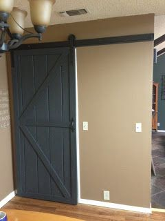 Wilker Do's: DIY Sliding Barn Door shows what to buy and how how to make the hardware.