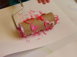 How to make your own roller stamp using a paint roller, toilet paper roll, tissue paper, and foam stickers from The Artful Child.